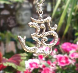 Om Pendant Available on Display Card