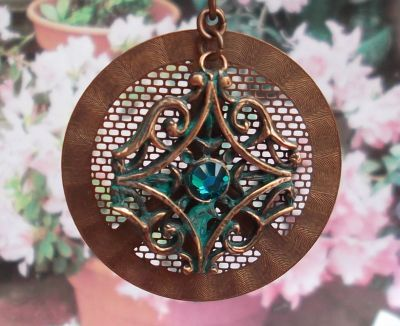 Copper Patina Pendant With Crystal And Peace Sign