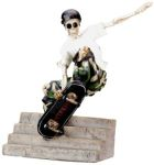 Skeleton Skating Off Stairs Figurine